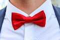 Red bow tie on white shirt. Royalty Free Stock Photo