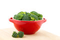 Red bowl with broccoli filled isolated Stock Images