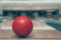 Red bowling ball on the track in the bowling center Royalty Free Stock Photo