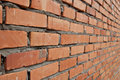 Red brick bricks arranged into a wall seen from sideway Stock Photos