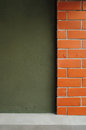 Red brick and green dark wall. Stock Image