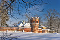 Red brick tower and the wall in winter Royalty Free Stock Photography