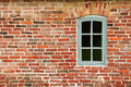 Red brick wal with window closeup Stock Photo