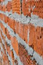 Red brick wall is composed of different bricks in texture Royalty Free Stock Photo