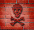 Red Brick Wall with Cross Bones Graffiti Royalty Free Stock Images