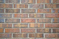 Red brick wall a with decorative marks carved into the bricks Royalty Free Stock Photography