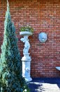 Red Brick wall with the Lion Face Sculpture
