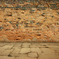 Red brick wall an old background with paving slabs Stock Images
