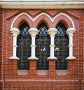 Red brick wall and stained glass window in Holy trinity Cathedral in Yangon, Myanmar, Burma Royalty Free Stock Photo