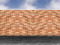 Red brick wall in a street Royalty Free Stock Photos
