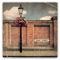 Red brick wall and street light an old vintage photograph of a with an old main sign Stock Images