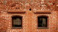 A red brick wall texture with two windows Stock Photos