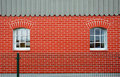 Red brick wall with windows Royalty Free Stock Photo