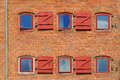Red brick wall with windows and shutters taken in copenhagen denmark Royalty Free Stock Photography