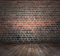 Red brick wall wooden floor Royalty Free Stock Photo