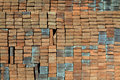 Red bricks neatly for transport to the city which is often found in the brick kiln of clay Royalty Free Stock Photo