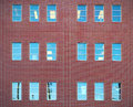 Red bricks and windows building office wall architecture downtown Royalty Free Stock Photo