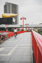 Red bridge across the sumida river in asakusa japan tokyo june people are walikng on district on june tokyo Royalty Free Stock Image