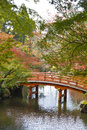 Red bridge on an autumn garden Royalty Free Stock Photo