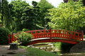 Red bridge in a japanese garden Royalty Free Stock Photo