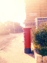 Red British Mail Box in the soft light on a city street Royalty Free Stock Photo