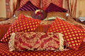 Red brocade cushions Stock Images