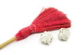 Red broom on the white background and used papers Stock Image