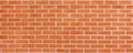 Red brown vintage brick wall with shabby structure. Horizontal wide brickwall background. Grungy red brick blank wall texture. Royalty Free Stock Photo