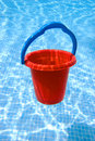 Red bucket with blue handle underwater Royalty Free Stock Photos