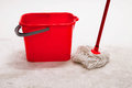Red bucket with cleaning mop. Royalty Free Stock Photo