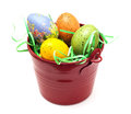 Red bucket with colorful easter eggs Royalty Free Stock Images