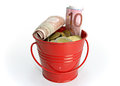 Red bucket with money small full of on white background Royalty Free Stock Photo