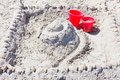 Red bucket in the sand Royalty Free Stock Photo