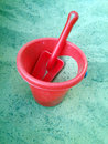 Red bucket and spade Royalty Free Stock Photo