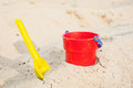 Red bucket and yellow spade Royalty Free Stock Photo