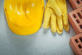 Red building bricks protective hard hat leather safety gloves on Royalty Free Stock Photo