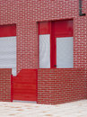 Red building facade with patio bricks vertical Stock Photos