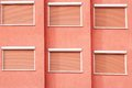 Red Building Facade with Six Closed Windows Shutters Royalty Free Stock Photo