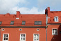 Red building with tile roof against blue sky Royalty Free Stock Photography