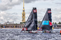 Red Bull Sailing Team and Alinghi catamarans on Extreme Sailing Series Act 5 catamarans race in St. Petersburg, Russia Royalty Free Stock Photo