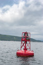 Red buoy floating in canada off the coast of cape breton nova scotia Royalty Free Stock Image