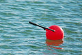 Red buoy floating in the water Stock Photo