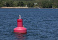 Red buoy in the ocean Royalty Free Stock Photo