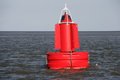 Red buoy a in the water Royalty Free Stock Photography