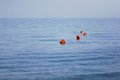 Red buoys floating in the calm blue sea Stock Images