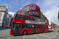 Red bus on piccadilly circus and famous advertisements in london england Royalty Free Stock Images
