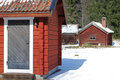Red cabins in winter Stock Photography