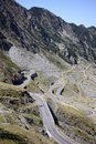 Red cable car over alpine road in Fagaras Royalty Free Stock Photo