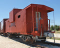 Red caboose on tracks Royalty Free Stock Photography