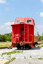 Red caboose under blue sky an old on a track skies Royalty Free Stock Photo
